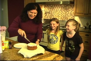 Lisa baking 9 cutting cake for kids